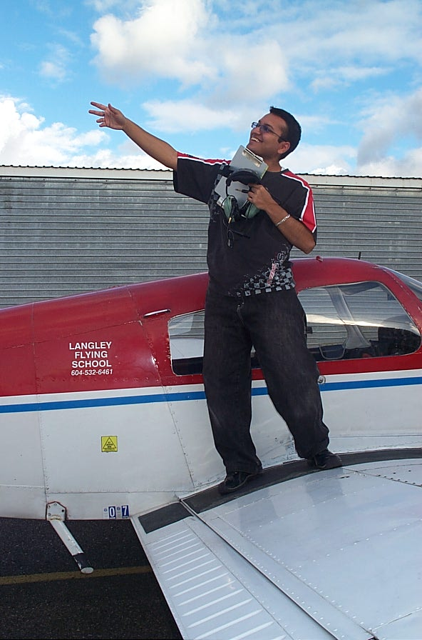 Aaron Pinto on the wing of Cherokee FKKF after completing his First Solo Flight on November 13, 2007.  Langley Flying School.