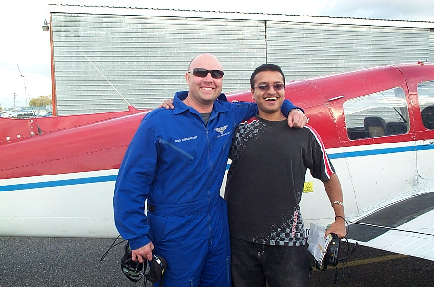 Aaron Pinto with Flight Instructor Rod Giesbrecht after completing his First Solo Flight on November 13, 2007.  Langley Flying School