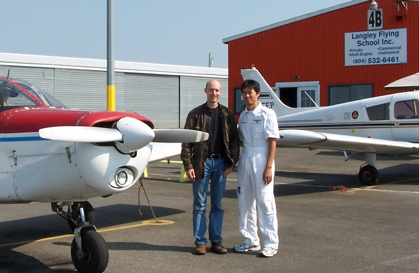 Pilot Adam Helfer with his Flight Instructor, Hoowan Nam, after completing his qualifying flight.  Langley Flying School.