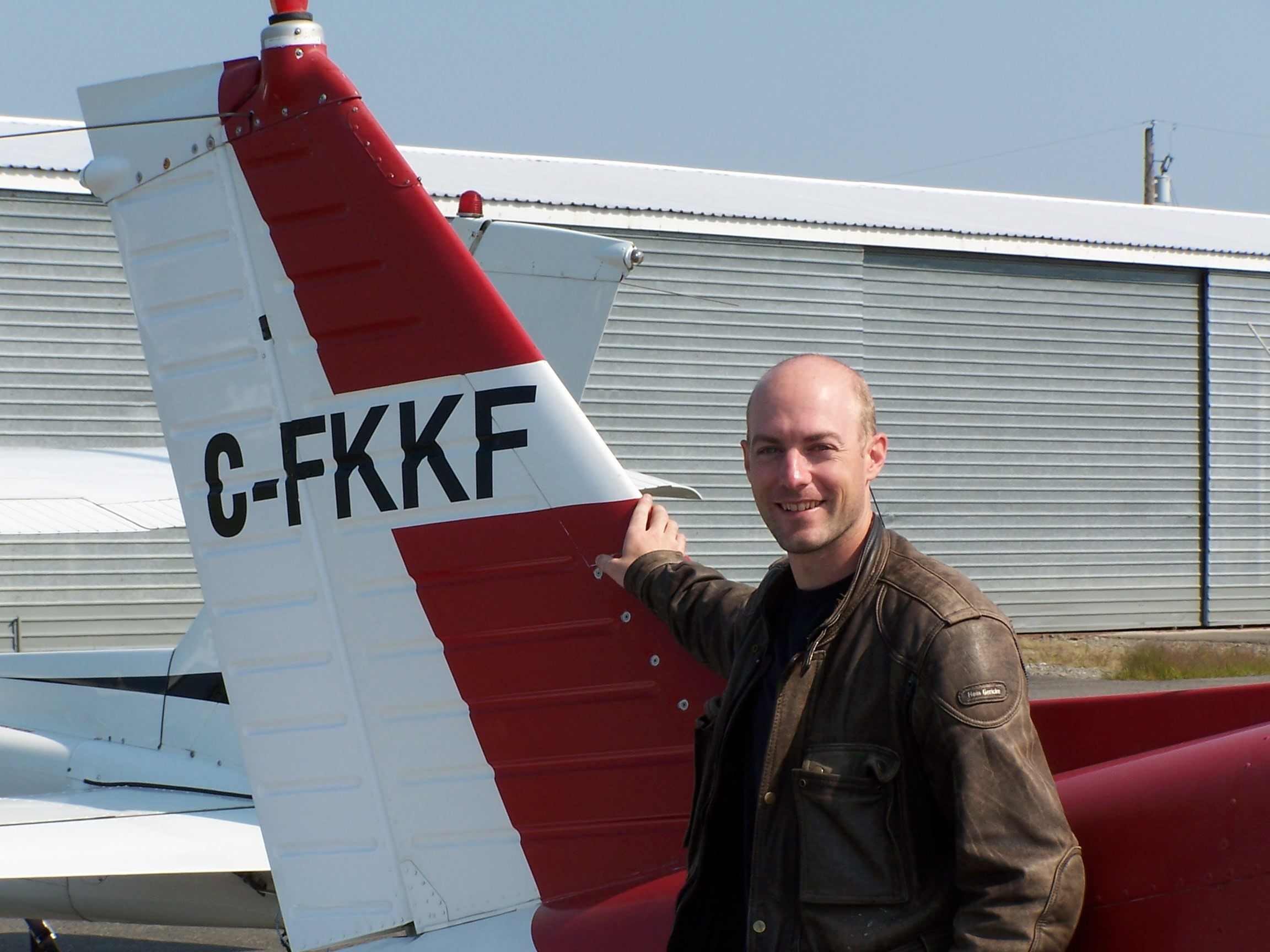 Adam Helfer, shortly after completing his Private Pilot Flight Test on August 30, 2009 with Pilot Examiner Paul Harris.  Congrats also to Adam's Flight Instructor, Hoowan Nam.  Langley Flying School.