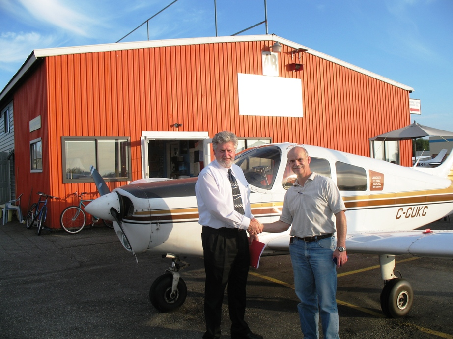 Alan March with Pilot Examiner Paul Harris.