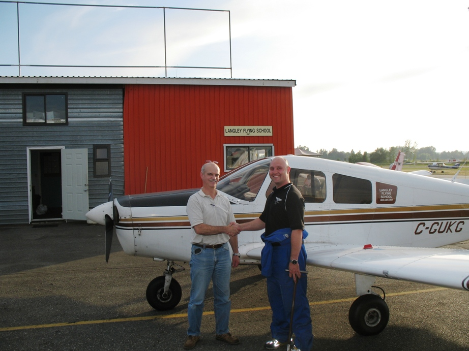Private Pilot Graduate Alan March with Flight Instructor Rod Giesbrecht after the completion of Alan's Flight Test on July 15, 2009.  Langley Flying School.