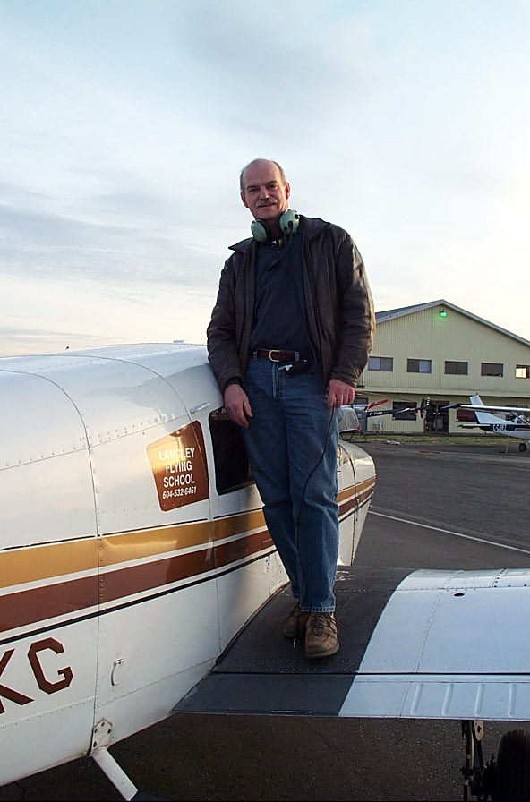 Alan March on the wing of Cherokee GURK after the completion of his First Solo Flight on December 8, 2007.  Langley Flying School.