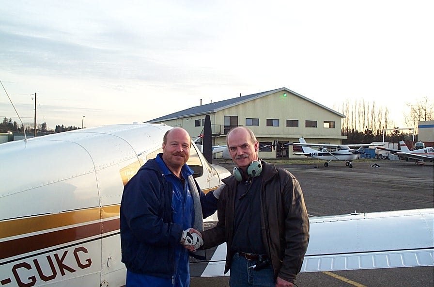 Alan March receives contratulations form Chief Flying Instructor David Parry after the completion of Alan's First Solo Flight on December 8, 2007.  Langley Flying School.
