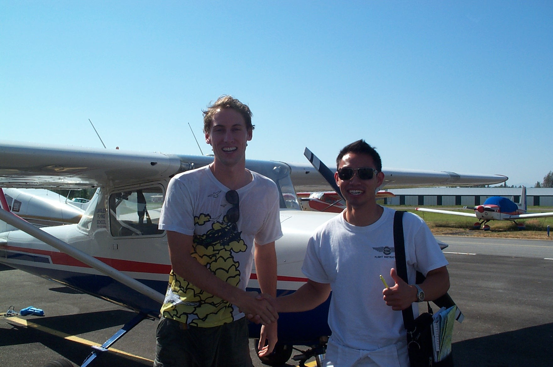 Alex Close with Flight Instructor Nam Vu, Langley Flying School.