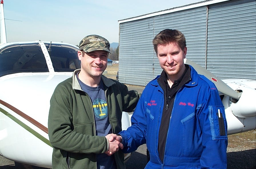 Alex Tremblay with Flight Instructor Phil Craig after the successful completion of Alex's Group 1 Instrument Rating Flight Test on March 12, 2009.  Langley Flying School.