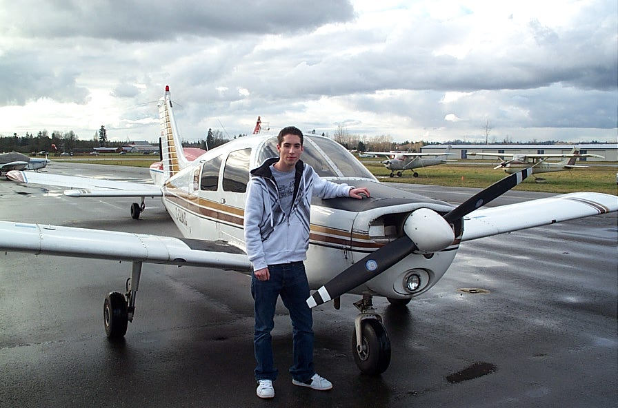 Alex Birch with Cherokee GUKG after completing his First Solo Flight on December 5, 2007.  Langley Flying School.
