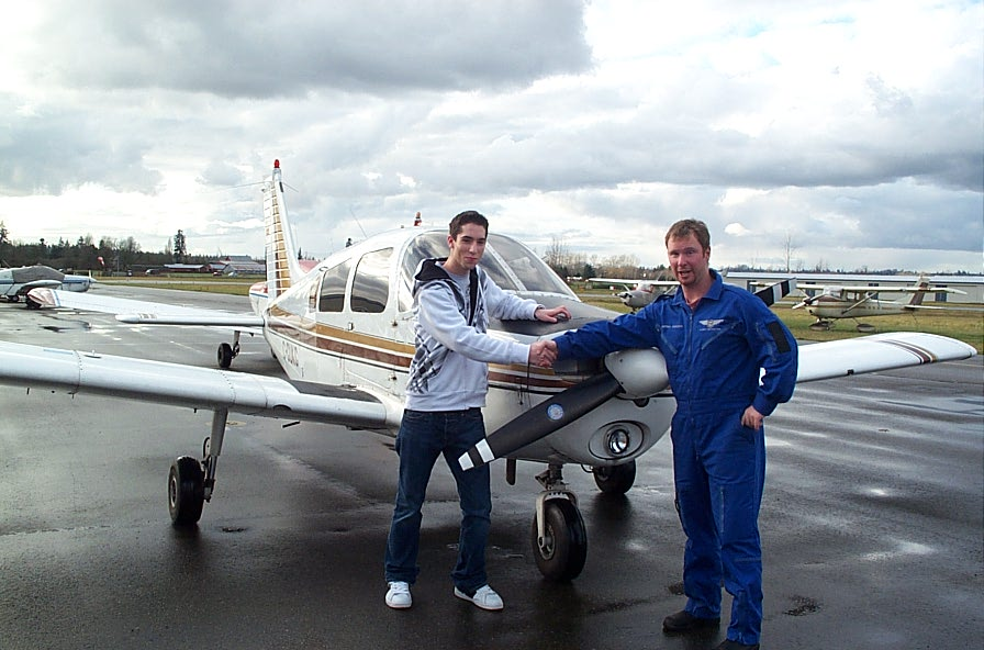 Alex Birch with Flight Instructor Darren Ferguson after completing his First Solo Flight on December 5, 2007.  Langley Flying School.