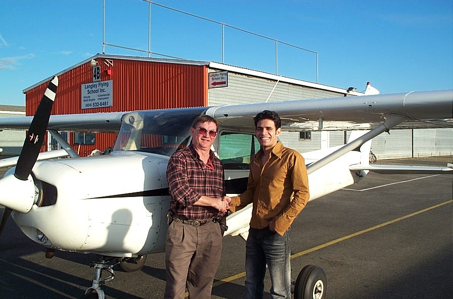 Ali Rumani with Pilot Examiner John Laing after the successful completion of Ali's Commercial Pilot Flight Test.  Langley Flying School.
