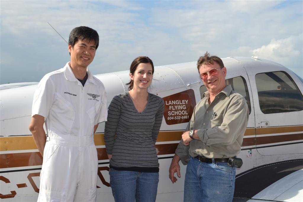 Allison Heathcote with John Laing and her Flight Instructor, Hoowan Nam after the completion of her Private Pilot Flight Test.  Langley Flying School.