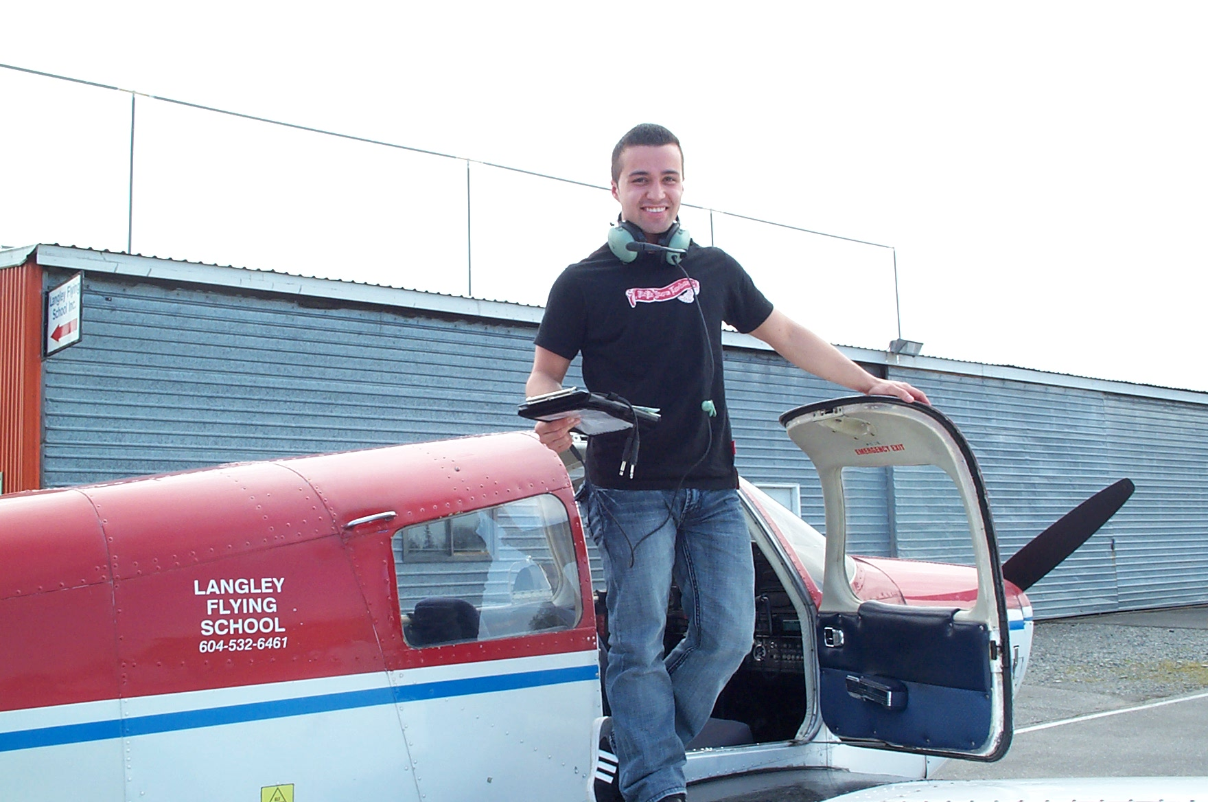 Andres Angulo on the wing of Cherokee FKKF after completing his First Solo Flight on April 14, 2010. Langley Flying School.