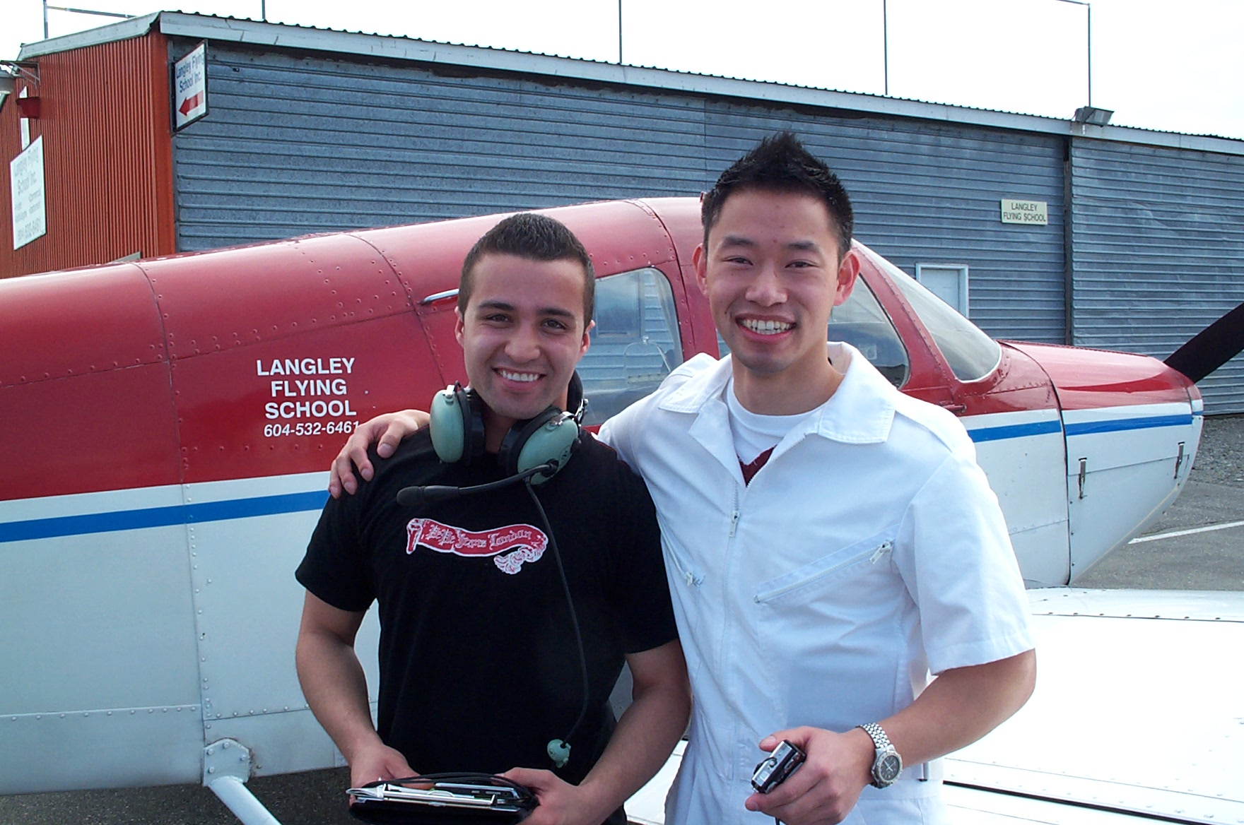 Andres Angulo with his Flight Instructor Nam Vu after completing his First Solo Flight on April 14, 2010.  Langley Flying School.