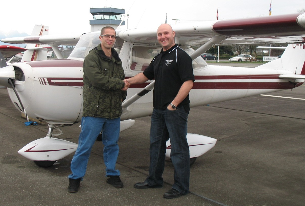 Andrew Otterstrom with Flight Instructor Rod Giesbrecht after the succesful completion of Andrew's Commercial Pilot Flight Test.  Langley Flying School.