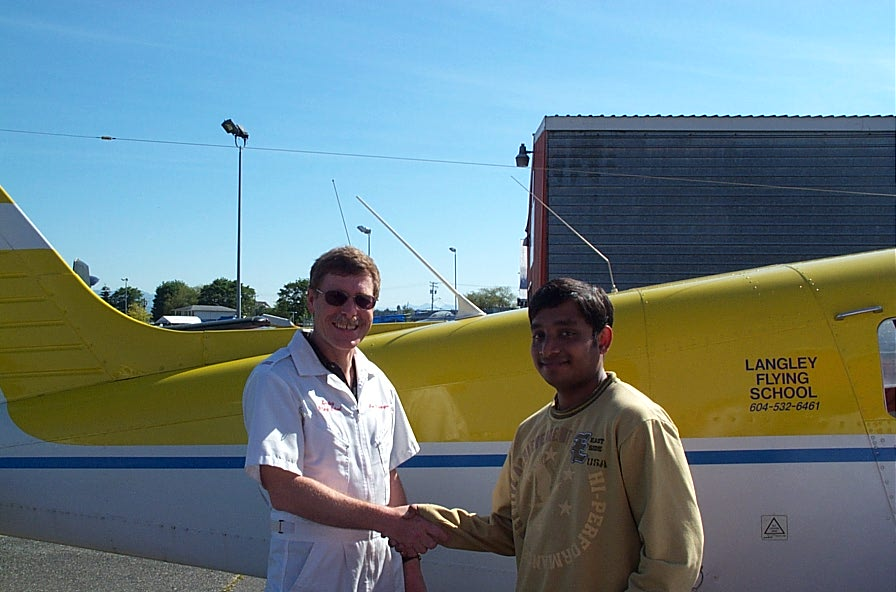 Aniket Chavan with Flight Instructor Peter Waddington after completing his First Solo Flight on May 29, 2007.  Langley Flying School