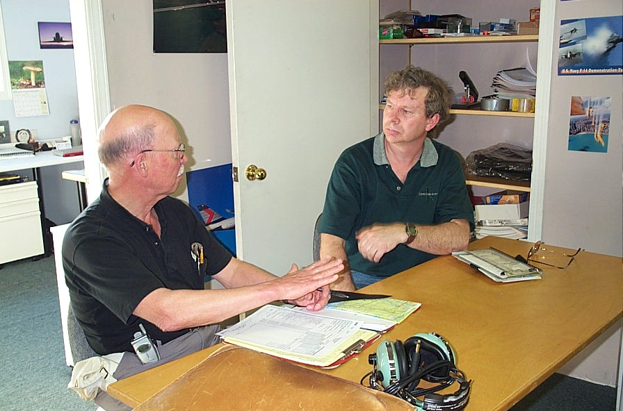 Brian Downing with Donn Richardson during the debriefing following Brian's successful Private Pilot Flight Test.  Langley Flying School.