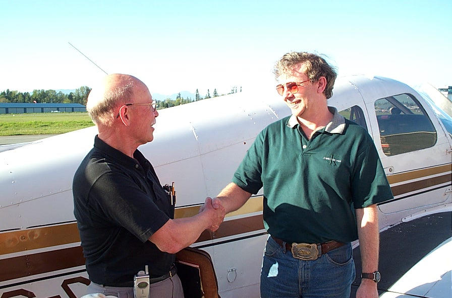 Brian Downing with Pilot Examiner Donn Richardson after the successful completion of Brian's Private Pilot Flight Test.  Langley Flying School.