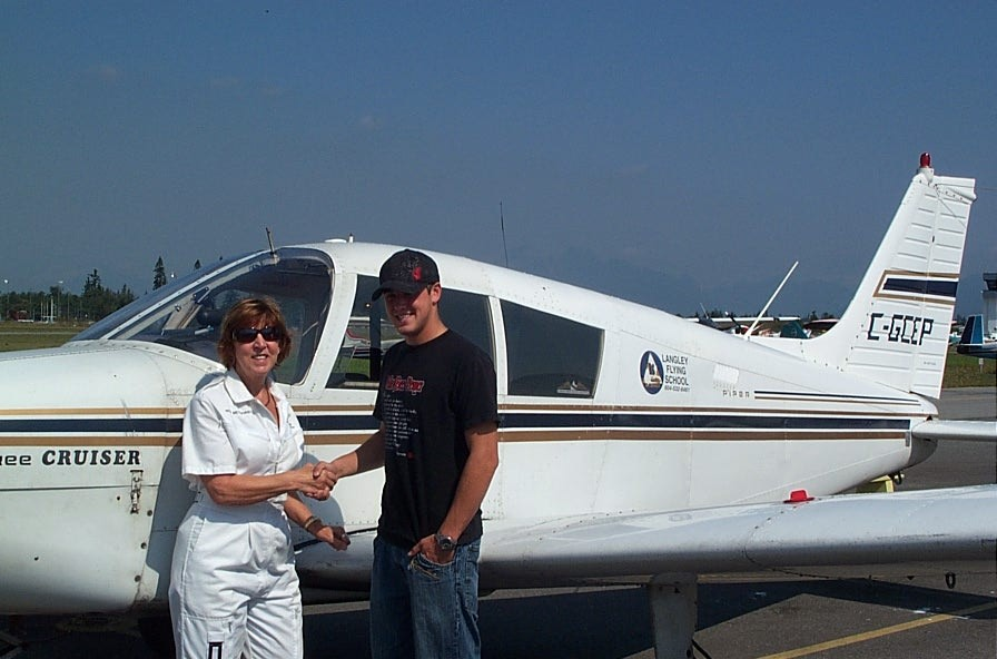 Pilot Brooklyn Anderson receives congrats from his Flight Instructor Rita Methorst.  August 31, 2009.  Langley Flying School.