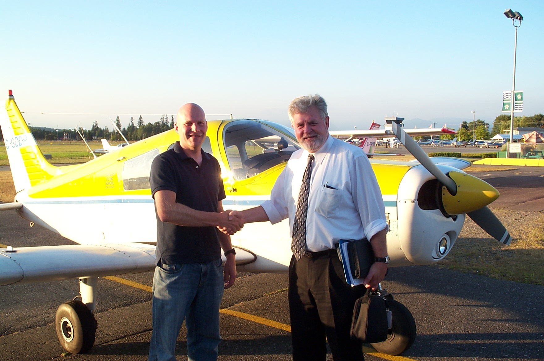 Carl Tingstad receives congratulations from Pilot Examiner Paul Harris following the successful completion of Carl's Commercial Pilot Flight Test on .  Langley Flying School.