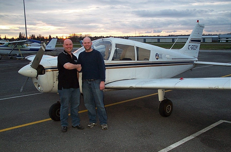 Carl Tingstad receives congratulations from his Flight Instructor, Rod Giesbrecht, after the successful completion of Carl's Private Pilot Flight Test.  Langley Flying School.