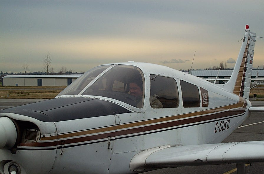 Carlos Calderon Gutierrez in Cherokeed GUKG after the successful completion of his First Solo Flight on January 15, 2008.  Langley Flying School.