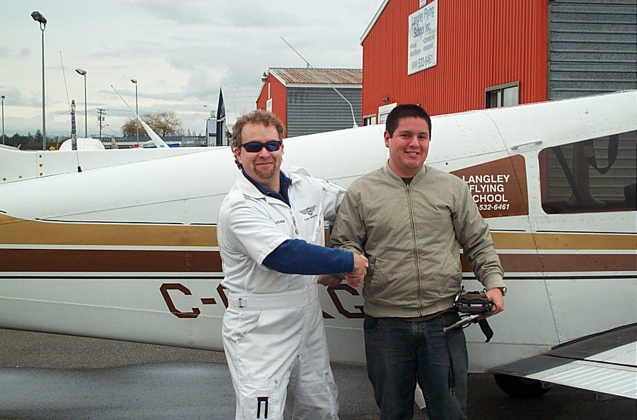 Carlos Calderon Gutierrez with Flight Instructor David Page after Carlos' First Solo Flight on January 15, 2008.  Langley Flying School.