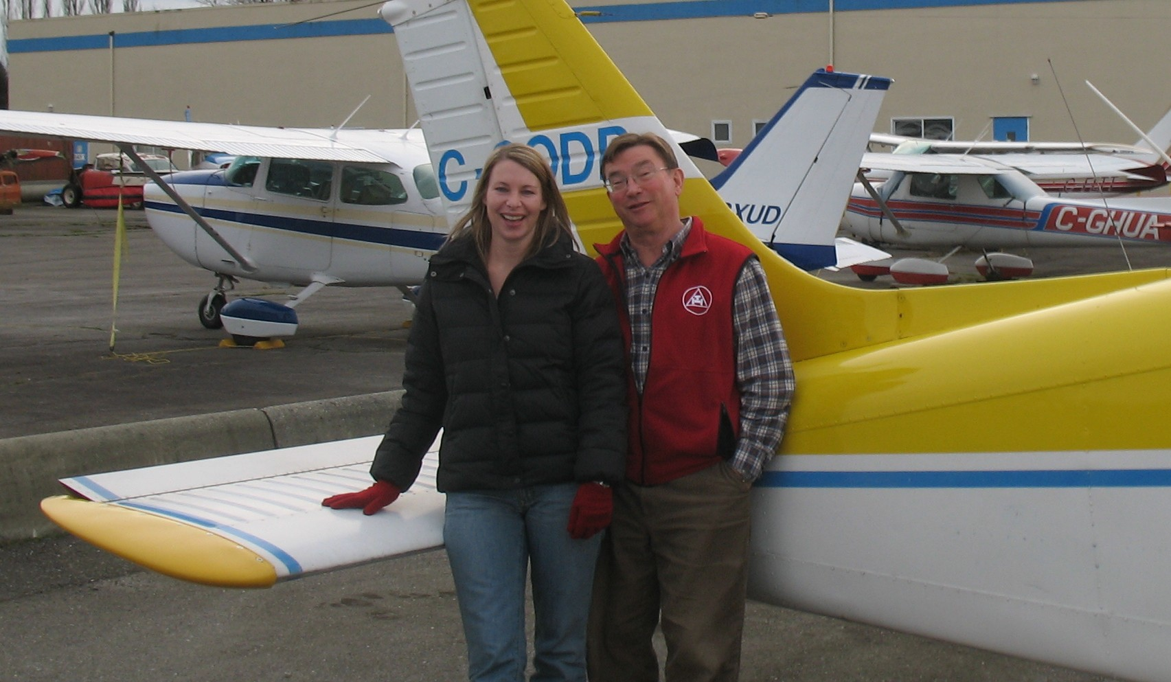 Christine Zboyousky with Pilot Examiner John Laing after the successful completion of Christine's Private Pilot Flight Test on January 7, 2010.  Langley Flying School.