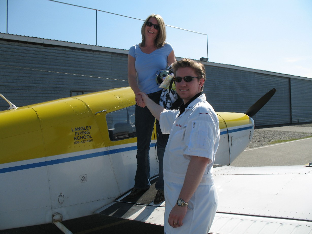 Christine Zbayousky with Flight Instructor Phil Craig after the completion of Christine's First Solo Flight in Cherokee GODP on April 20, 2009.  Langley Flying School.