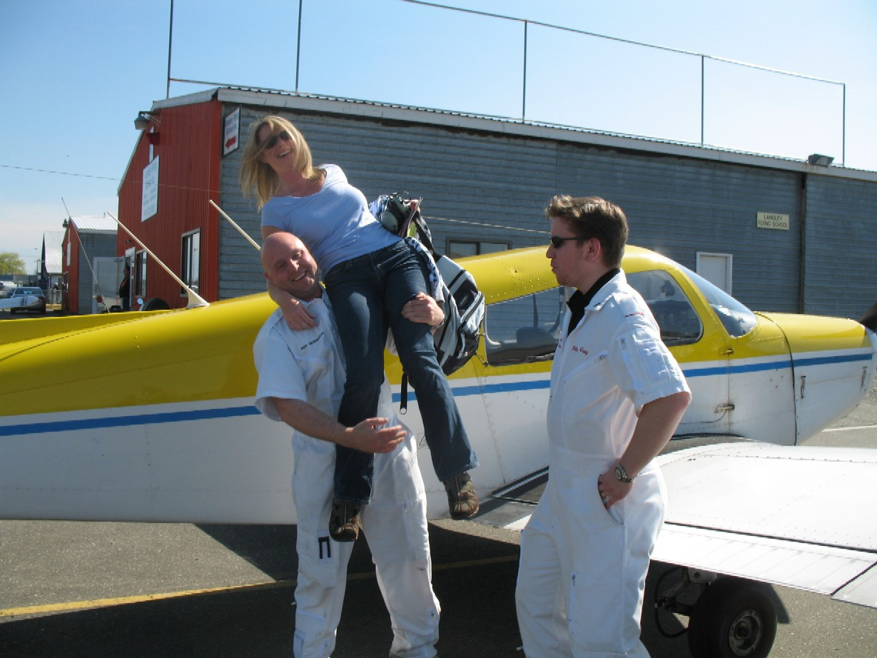 Christine Zboyousky with Flight Instructors Rod Giesbrecht and Phil Craig after the completion of Christine's First Solo Flight on April 20, 2009.