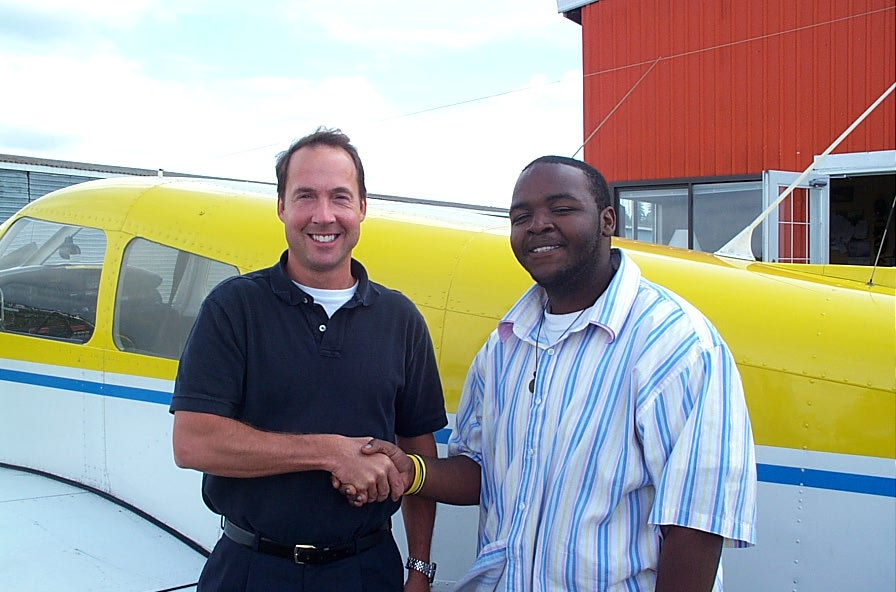 Christopher Russell with Jeff Durand after successful completion of Chris' Private Pilot Flight Test, September 5, 2007, Langley Flying School