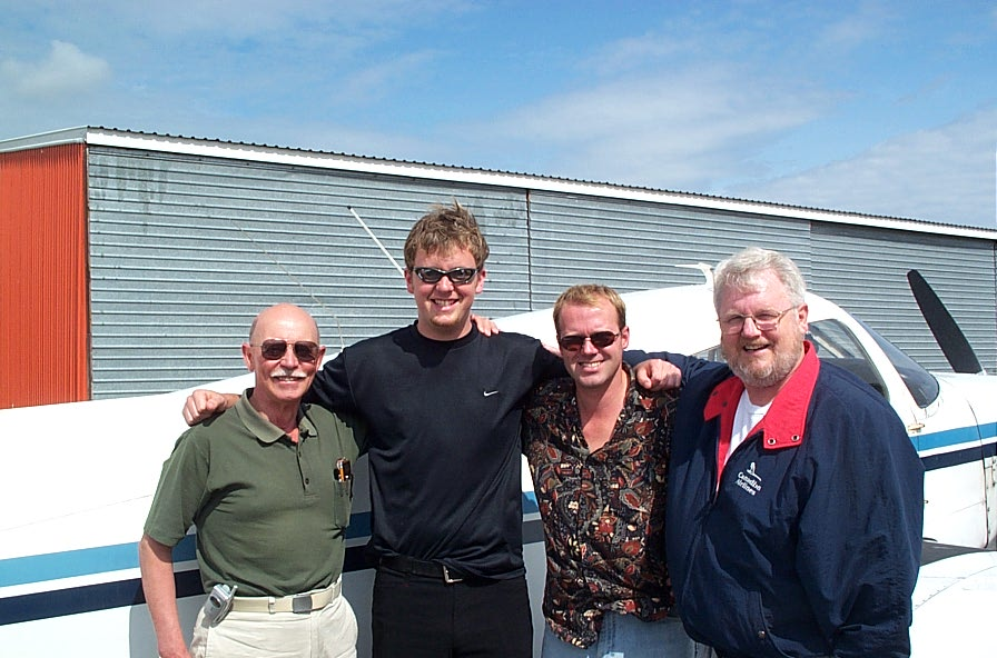 Commercial Pilot Cullen Worth (second from left) with (left to right) Pilot Examiner Donn Richardson, Flight Instructor David Woollam, and Cullen's Father, Brian Worth (retired Canadian Navy and Air Canada pilot).  Langley Flying School.