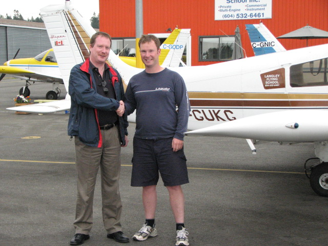 Flight Instructor Darren Ferguson with Transport Canada Inspector Peter Cox.  Langley Flying School
