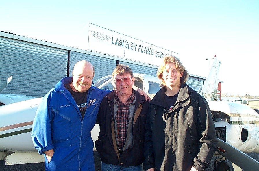 Darren Kroeker with John Laing and his Flight Instructor, David Parry.