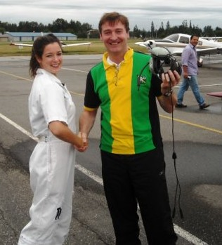 David Whiteley receives congratulations from Flight Instructor Naomi Jones after the completion of David's First Solo Flight on September 6, 2009.  Langley Flying School.