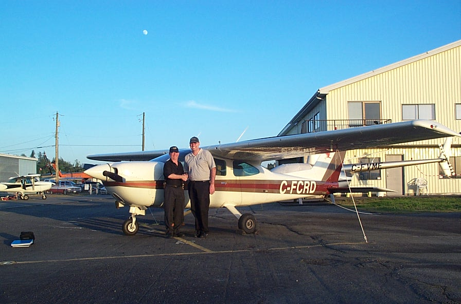 David Day receives congratulations from Pilot Examiner John Laing after the successful completion of David's Private Pilot Flight Test on May 16, 2008.  Langley Flying School.