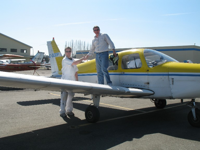 Dave Marshall is congratulated by Flight Instructor Phil Craig after the successful completion of his First Solo Flight on April 7, 2009.  Langley Flying School.