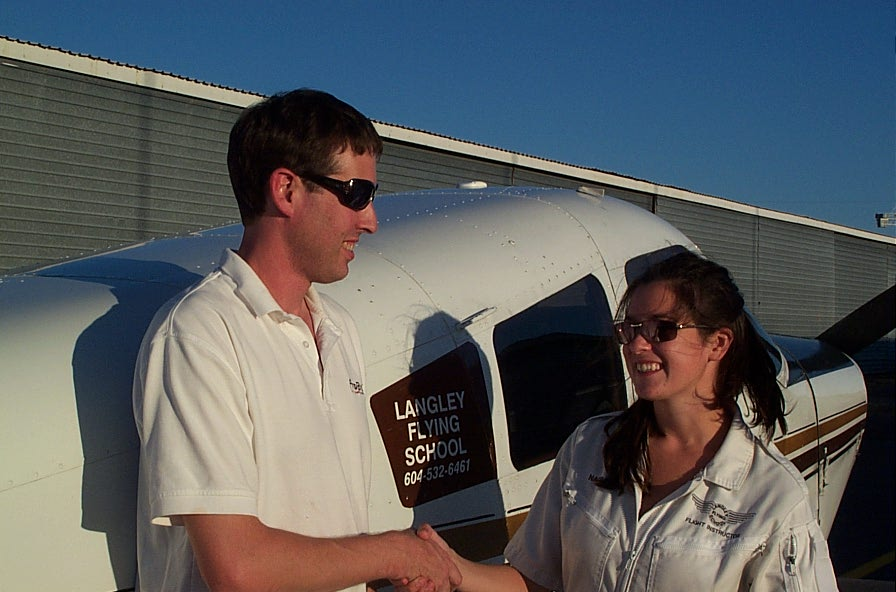 Dean Bicknell is congratulated by Flight Instructor Naomi Jones after the completion of his First Solo Flight.  Langley Flying School.