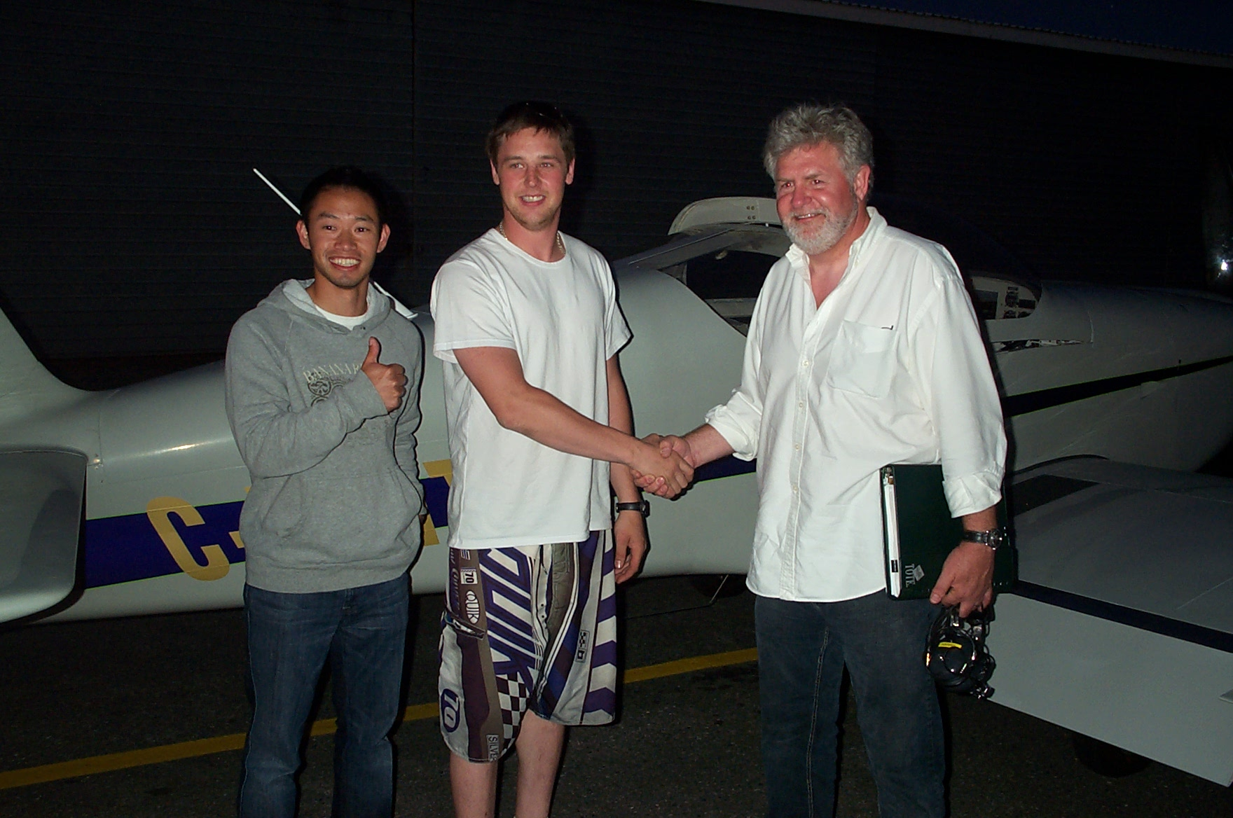 Derrek Sutter receives contratulations from his Flight Instructor Nam Vu and Pilot Examiner Paul Harris, following the successful completion of Derrek's Private Pilot Flight Test on July 6, 2010. Congrats also to Derrek's previous Flight Instructors, Rod Giesbrecht and Naomi Jones.  Langley Flying School.