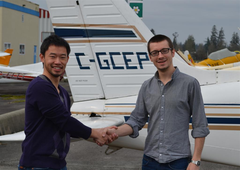 Private Pilot Florian James is congratulated by his Flight Instructor, Nam Vu, after the successful completion of Florian's Flight Test on April 23, 2011.  Langley Flying School.