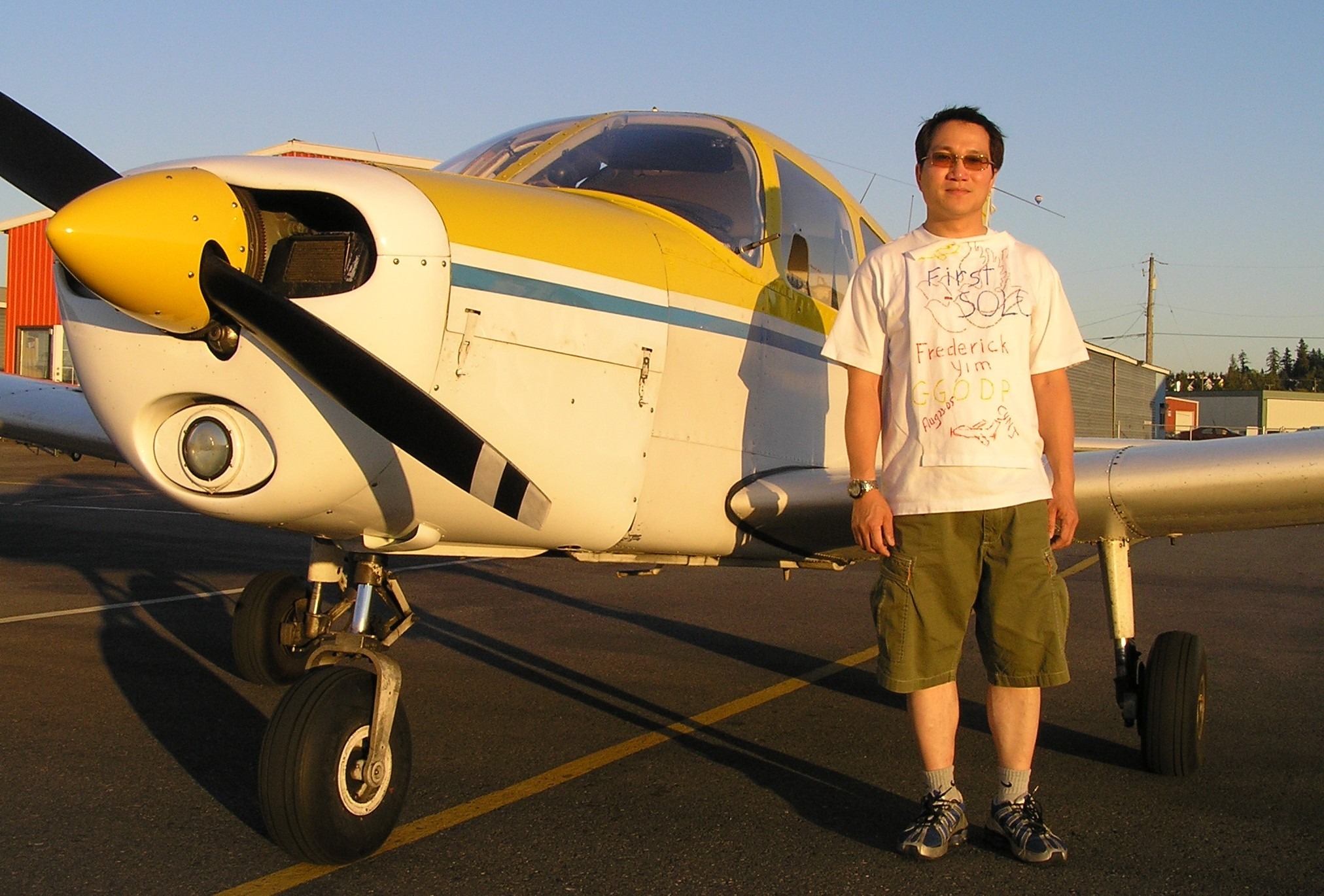 Frederick Yim with Cherokee GODP after his First Solo Flight.  Langley Flying School.