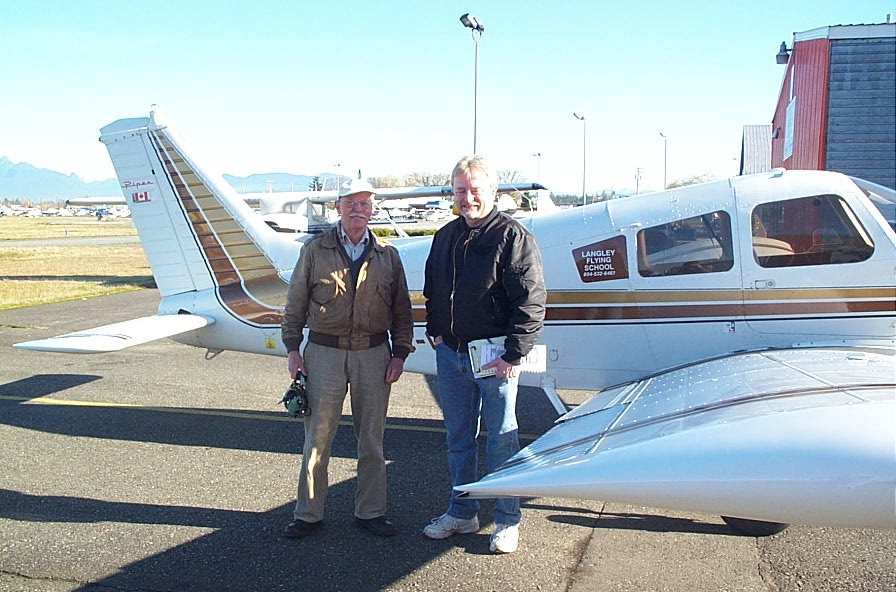 Glen Bell with Pilot Examiner Donn Richardson after the successful completion of Glen's Private Pilot Flight Test.  Langley Flying School