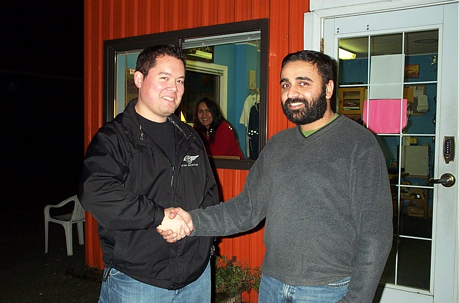 Commercial Pilot Gobind Sandhanwalia receives contratulations form Flight Instructor Justin Chung after the successful completion of Gobind's Group 1 (Multi-engine) Instrument Rating Flight Test on November 29, 2007.  Langley Flying School.