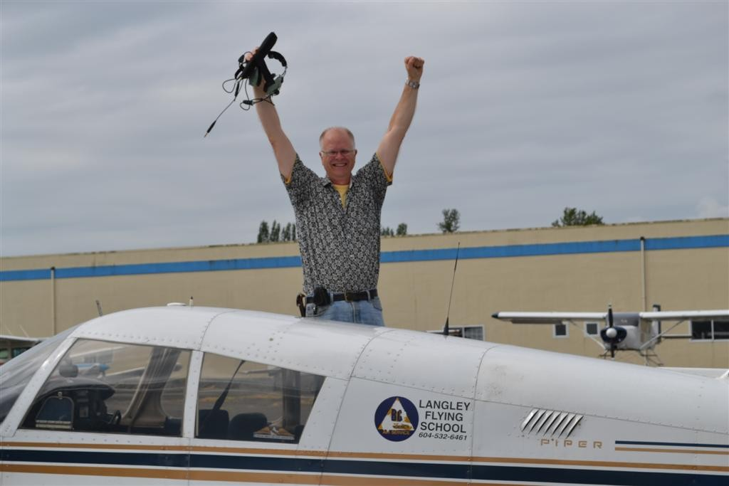 Greg Booker on the wing of Cherokee GCEP after the completion of his First Solo Flight on August 23, 2011.  Langley Flying School