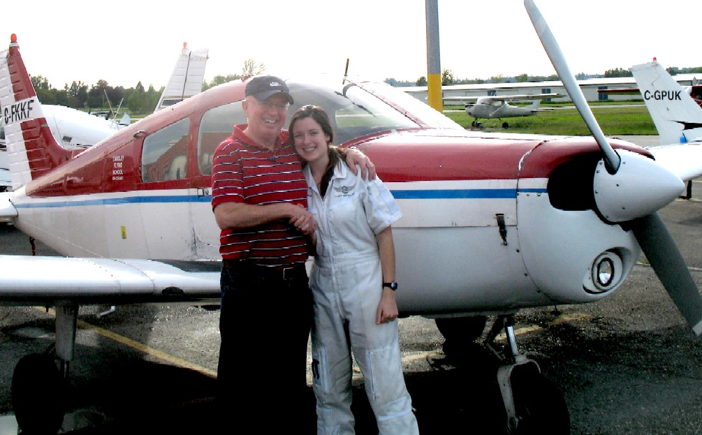 Gregg Goodfellow with his Flight Instructor, Naomi Jones, after the successful completion of Gregg's Private Pilot Flight Test on May 17, 2009.  Langley Flying School.