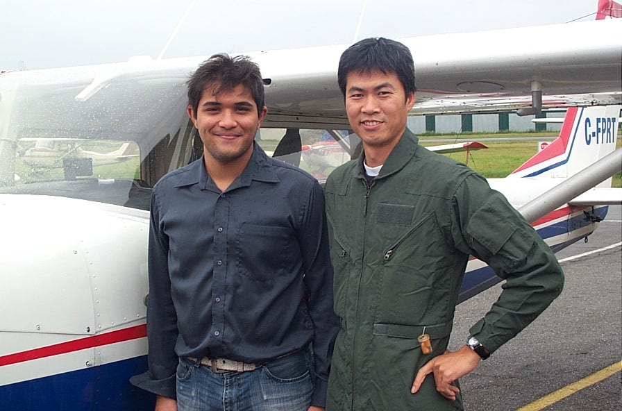 Hussian Lehry with Flight Instructor Hoowan Nam after the completion of Hussian's First Solo Flight on October 16, 2007 in Cessna FPRT.  Langley Flying School.