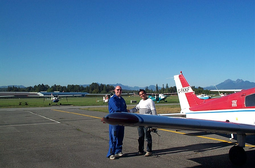 Private Pilot Student Ishan Patel with Flight Instructor Rod Giesbrecht after completing his First Solo Flight on September 22, 2009.  Langley Flying School.