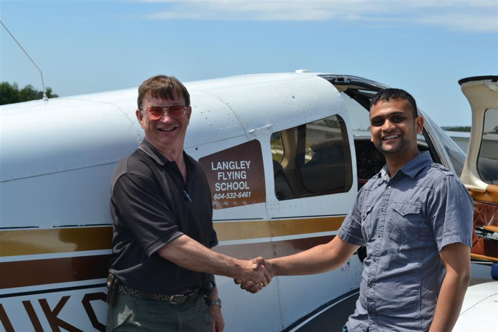 Ishan Patel receives contgratulations from his Pilot Examiner John Laing, after the successful completion of Ishan's Private Pilot Flight Test on July 2, 2011.  Langley Flying School.
