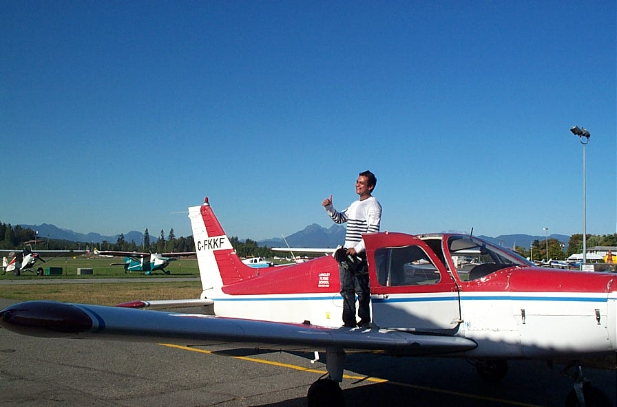 Ishan Patel on the wing of Cherokee FKKF after completing his First Solo Flight on September 22, 2009.  Langley Flying School.