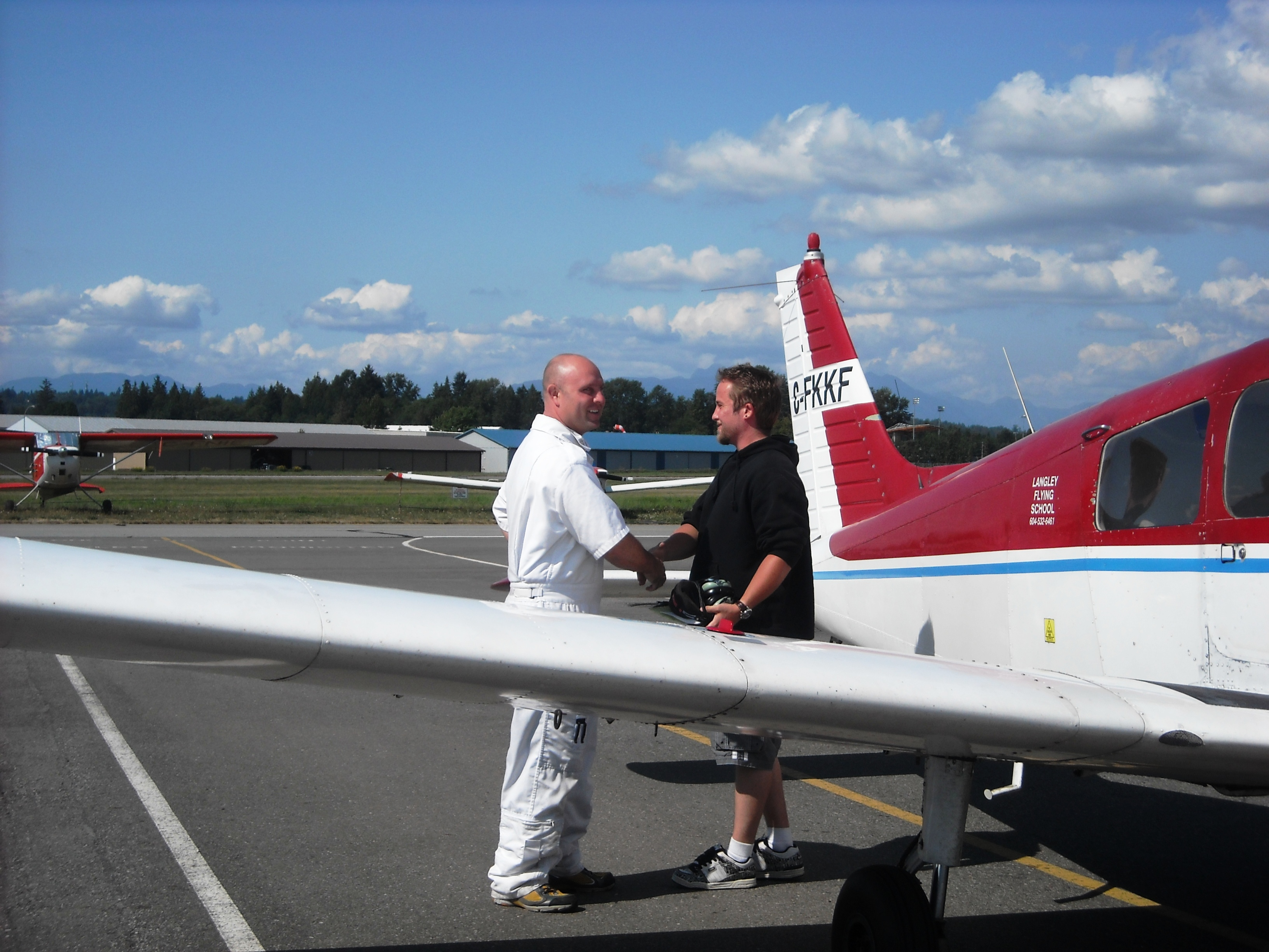 Private Pilot Student Jason Nel with Flight Instructor Rod Giesbrecht after the completion of Jason's Frist Solo Flight on August 22, 2009.  Langley Flying School.