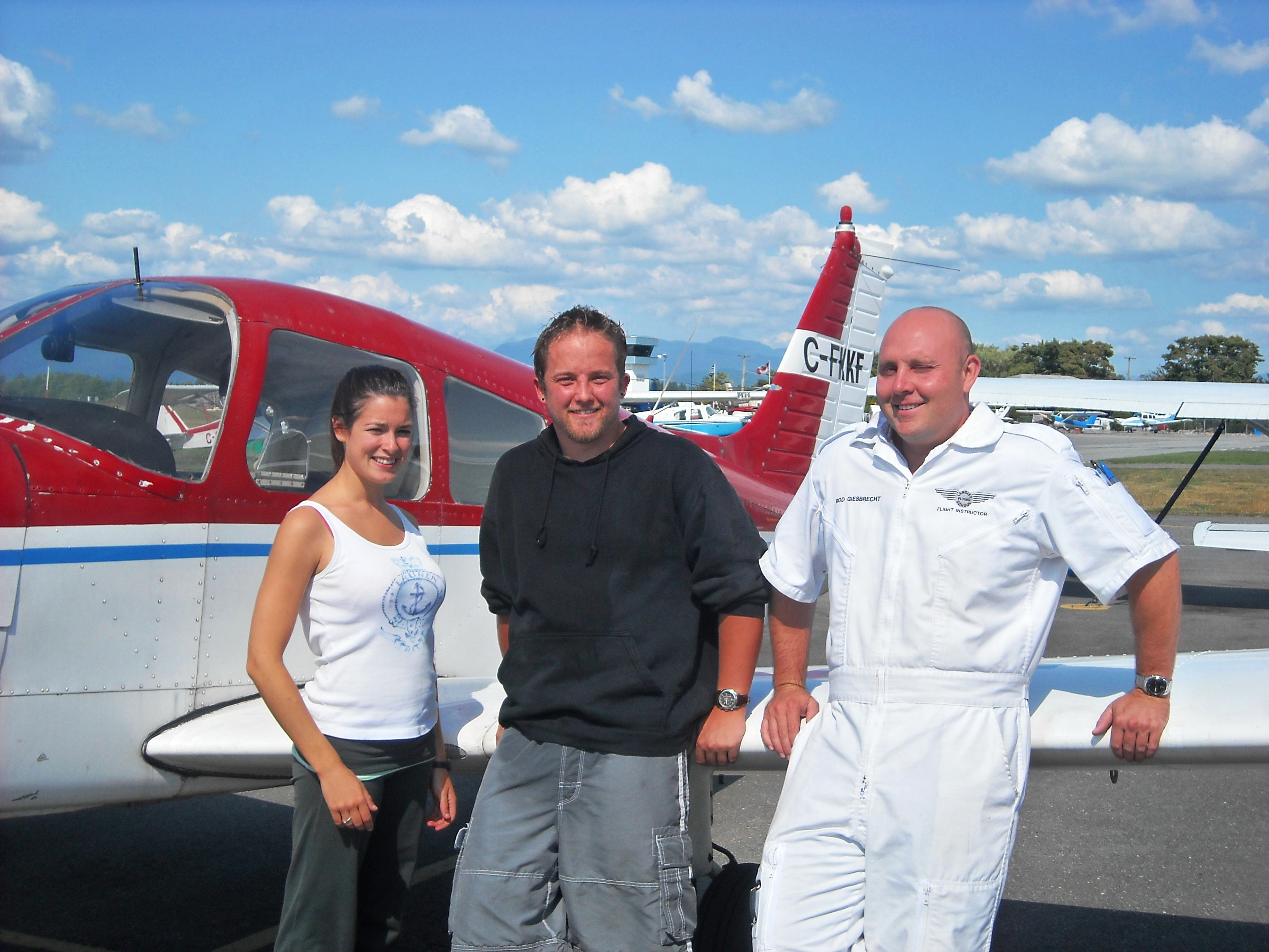 Naomi Jones and Rod Giesbrecht with Jason Nel.  Langley Flying School.