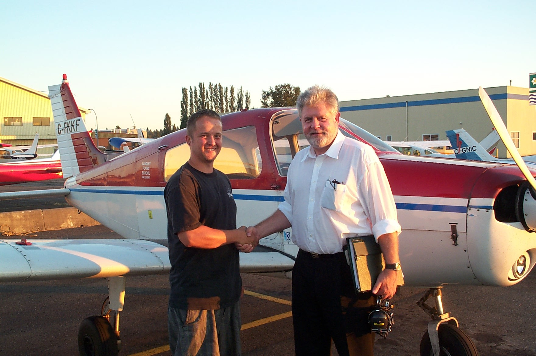 Jason Nel with Pilot Examiner Paul Harris after the successful completion of Jason's Private Pilot Flight Test.  Langley Flying School.